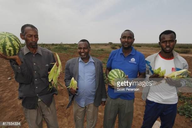 Somali village elders hold watermelons and corn harvested from a Farmer Field School organized by the Irish aid agency ConcernWorldwise as the Horn...