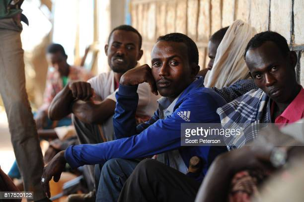 Somali villagers who have benefited from food and cash donations mobilized by a WhatsApp group called 'Daryeel' formed by diaspora Somalis from their...