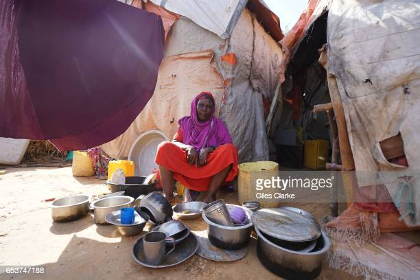 Somali woman outside her shelter at an Internally Displaced Persons camp in Mogadishu According to an United Nations February 2017 OCHA report famine...