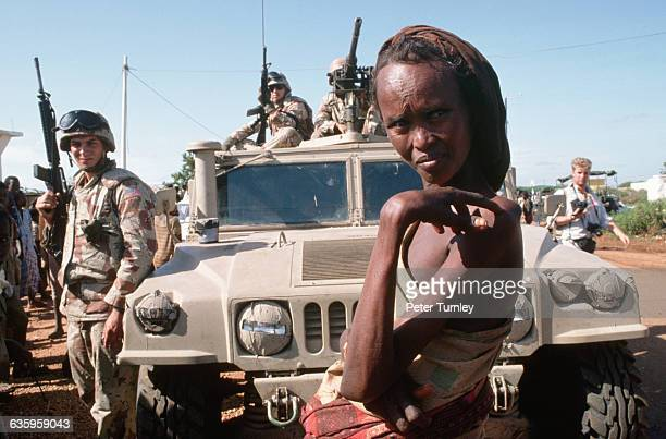 A Somali woman stands near a military vehicle and US soldiers during 'Operation Restore Hope' In the 1980s a civil war in Somalia began when warlord...
