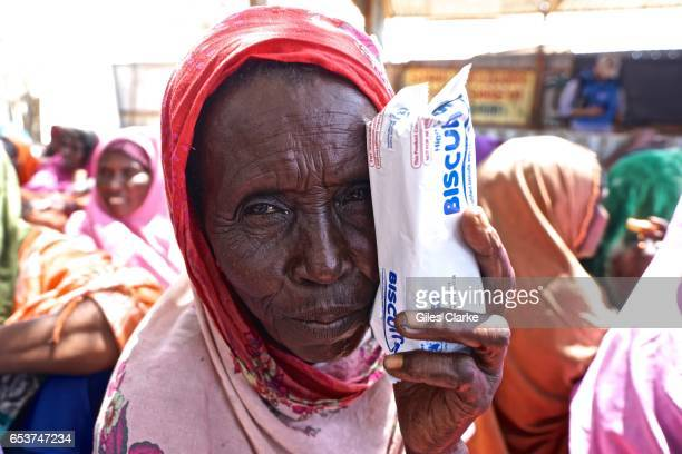 Somali woman waits before registering for humanitarian aid at a World Food Program center in Mogadishu Personal details and fingerprints are recorded...