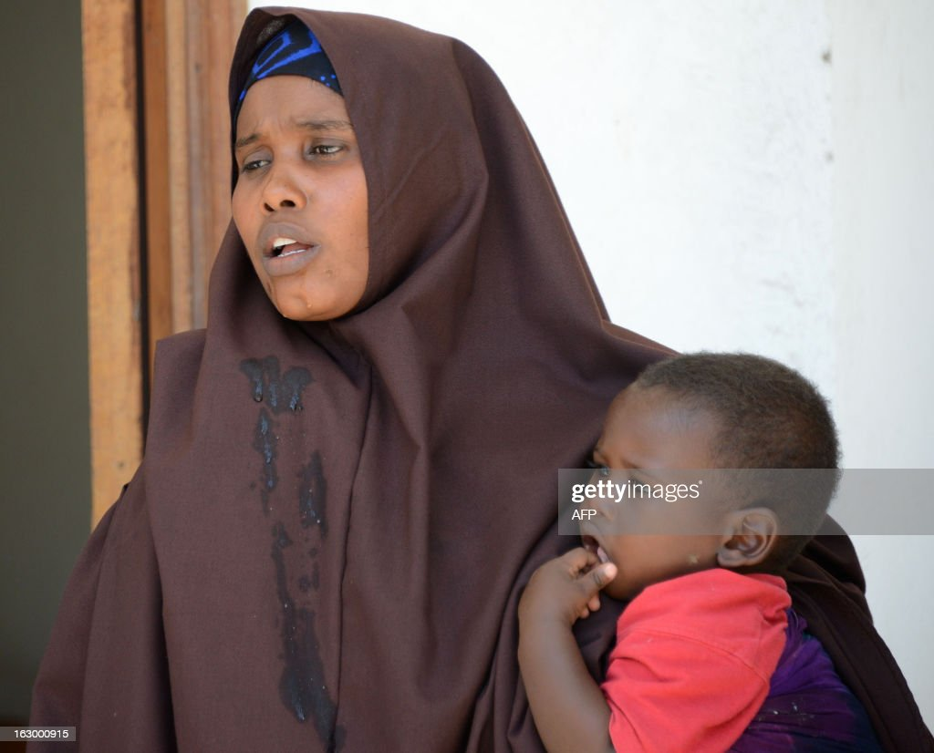 A Somali woman, who was sentenced to a year in jail after she told a reporter she was raped by security forces, holds her baby at the court house in Mogadishu on March 3, 2013. A Somali appeals court dropped the charges against the woman but said the journalist will remain in jail for six months. Last month the woman and journalist Abdiaziz Abdinuur, 25, were found guilty of offending state institutions and sentenced to a year in jail. Abdinuur -- who was detained on January 10 while researching sexual violence in Somalia, but did not air or print any report after interviewing the woman -- was also found guilty of 'making a false interview, and entering the house of a woman whose husband was not present.' AFP PHOTO / Mohamed Abdiwahab