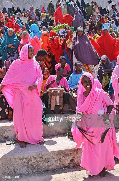 Somali women dance during a ceremony marking the first anniversary of the withdrawal of terror group AlShabab from Mogadishu at Konis Stadium in the...