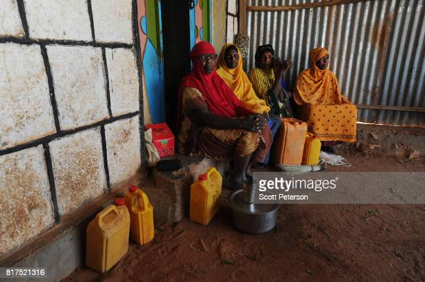 Somali women who have benefited from food and cash donations mobilized by a WhatsApp group called 'Daryeel' formed by diaspora Somalis from their own...