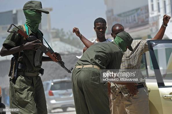 Somalia federal government soldiers conduct random check of public transport vehicles during a patrol on the streets of Mogadishu on February 18 as...