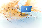 The flag of Somalia pinned on the map. Horizontal orientation. Macro photography.