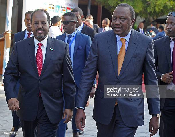 Somalia President Hassan Sheikh Mohamoud recieves his Kenyan counterpart Uhuru Kenyatta in the Somalian capital Mogadishu which is hosting a historic...