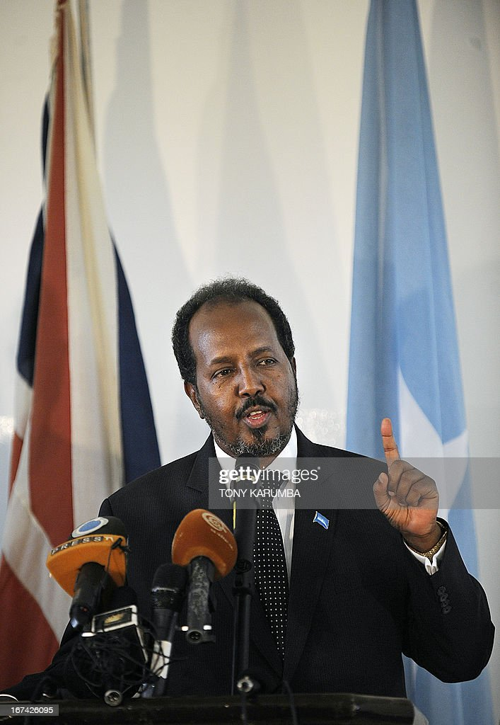 Somalia President Hassan Sheikh Mohamud addresses a press conference on April 25, 2013 in Mogadishu after the re-opening of Britain's embassy in the city. Hague inaugurated the embassy after a 22-year absence, becoming the first EU nation to return to the conflict-torn capital. AFP PHOTO/Tony KARUMBA