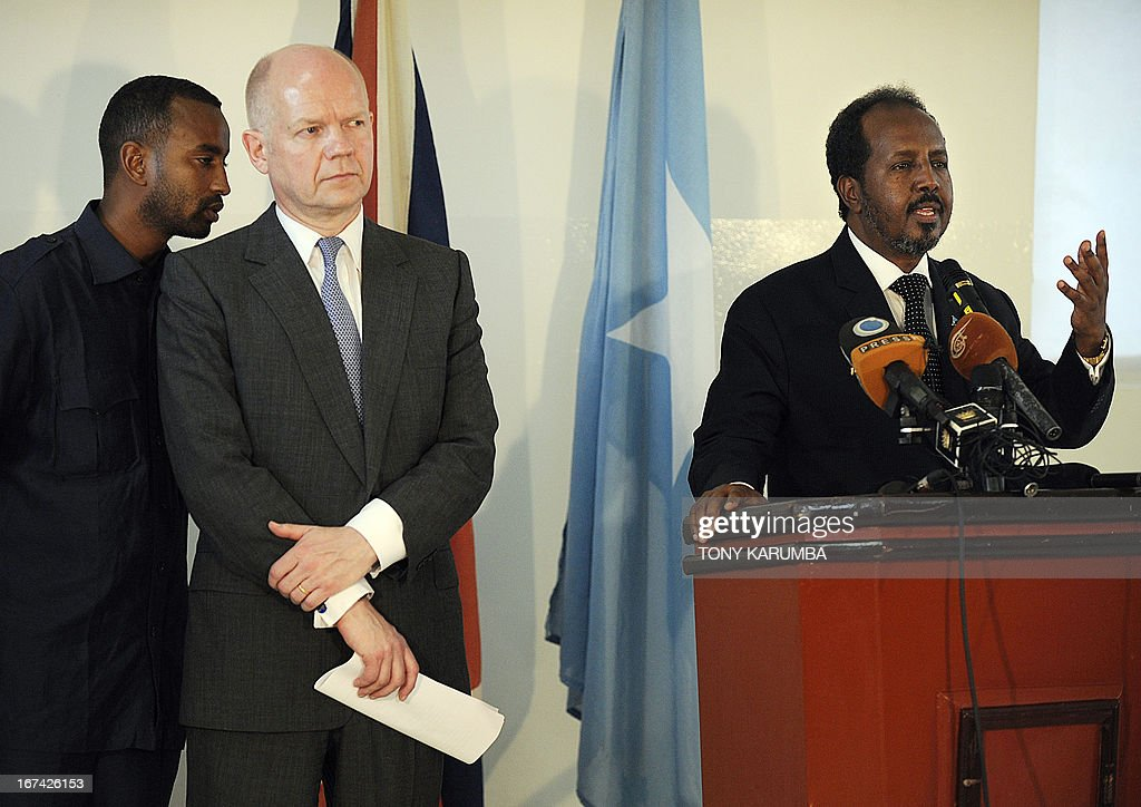 Somalia President Hassan Sheikh Mohamud addresses a press conference on April 25, 2013 in Mogadishu as Britain's Foreign Minister William hague listens after the re-opening of Britain's embassy in the city. Hague inaugurated the embassy after a 22-year absence, becoming the first EU nation to return to the conflict-torn capital. AFP PHOTO/Tony KARUMBA