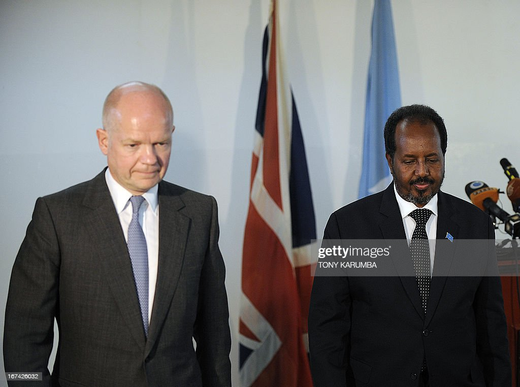 Somalia President Hassan Sheikh Mohamud and Britain's Foreign Minister, William Hague leave the venue of a press conference on April 25, 2013 in Mogadishu after the re-opening of Britain's embassy in the city. Hague inaugurated the embassy after a 22-year absence, becoming the first EU nation to return to the conflict-torn capital. AFP PHOTO/Tony KARUMBA