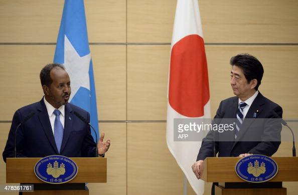 Somalian President Hassan Sheikh Mohamud and Japanese Prime Minister Shinzo Abe attend a joint press conference after their meeting at the latter's...