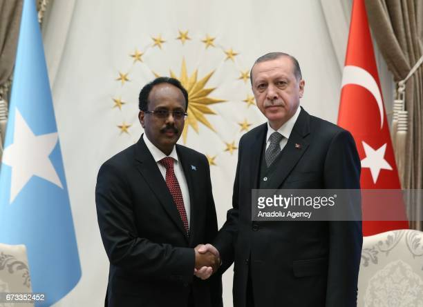 Somalian President Mohamed Abdullahi Mohamed and Turkish President Recep Tayyip Erdogan shake hands before their meeting after their an welcoming...