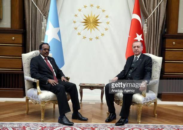 Somalian President Mohamed Abdullahi Mohamed and Turkish President Recep Tayyip Erdogan pose before their meeting after their an welcoming ceremony...