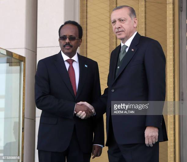 Somalian President Mohamed Abdullahi Mohamed is welcomed by Turkish President Recep Tayyip Erdogan during an official welcoming ceremony at...