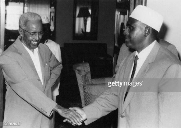 Somalian Prime Minister Abdurashid Ali Shermarke and Somalian President Aden Abdullah Osman Daar shake hands 26 June 1960 in Mogadishu Somalia On 1st...