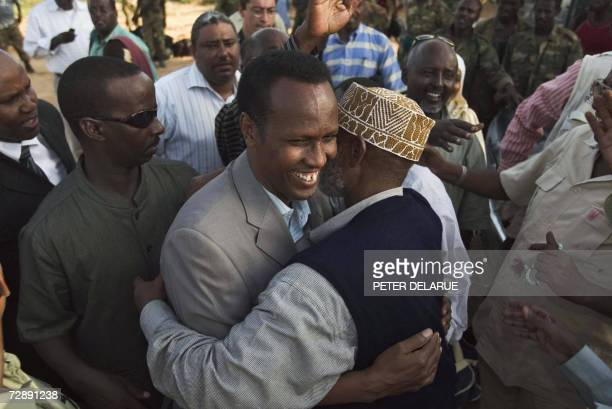 Somalian Prime Minister Ali Mohamed Gedi hugs an unidentified man as he arrives in Afgoye to celebrate the liberation of the city from the Union of...