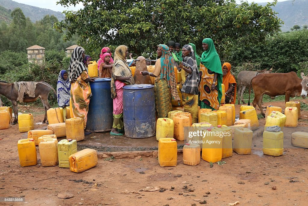 Somalian refugees living in the Erar region of Ethiopia's Harar city are seen at their camp as they face water shortage on June 26, 2016. Somalian refugees walk around 20 kilometers everyday to get water from the Harar and go back to their camps.