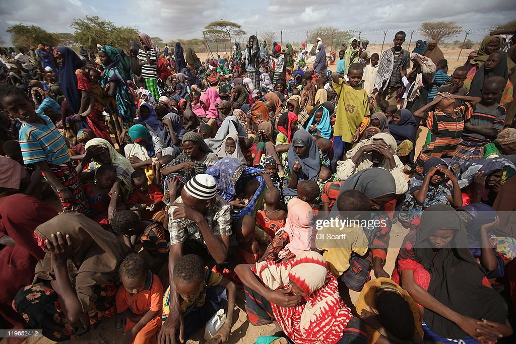 Somalian refugees wait in the registration area of the Dagahaley refugee camp which makes up part of the giant Dadaab refugee settlement on July 23...