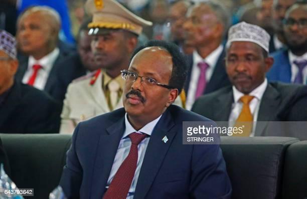 Somalia's new President Mohamed Abdullahi Mohamed looks on during its inauguration at the Mogadishu airport on February 22 2017 Somalia's capital...