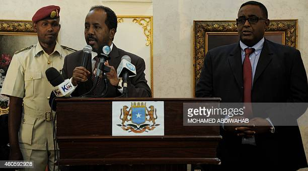 Somalia's newly appointed Prime Minister Omar Abdirashid Ali Sharmarke listens as President Hassan Sheikh Mohamud a speech following his appointment...