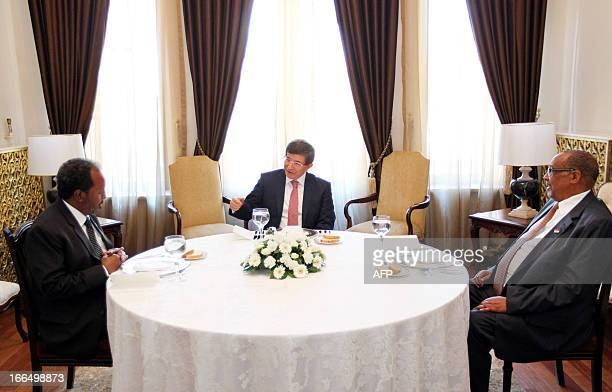 Somalia's President Hassan Sheikh Mohamud Turkish Foreign Minister Ahmet Davutoglu and Somaliland's President Ahmed Siilaanyo speak during a meeting...
