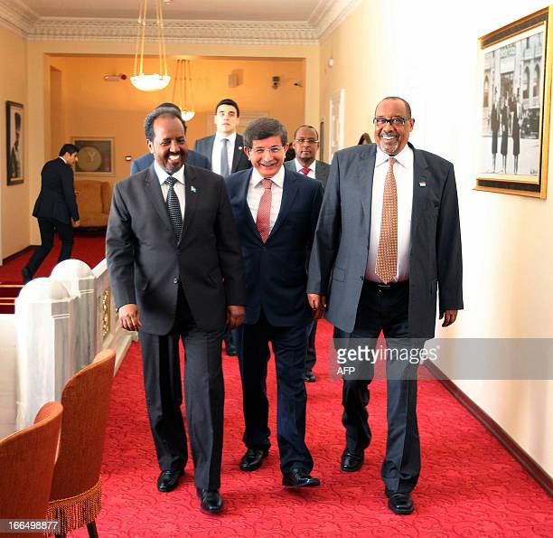 Somalia's President Hassan Sheikh Mohamud Turkish Foreign Minister Ahmet Davutoglu and Somaliland's President Ahmed Siilaanyo laugh during a meeting...