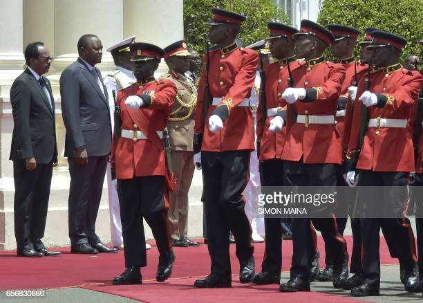 Somalias President Mohamed Abdullahi Mohamed and his Kenyan counterpart Uhuru Kenyatta watch the honor guard as they parade on March 23 2017 at the...