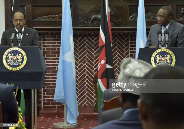 Somalias President Mohamed Abdullahi Mohamed and his Kenyan counterpart Uhuru Kenyatta give a joint press conference on March 23 2017 at the State...