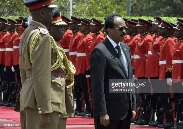 Somalias President Mohamed Abdullahi Mohamed walks past the honor guard as he arrives on March 23 2017 at the State house in the Kenyan capital...