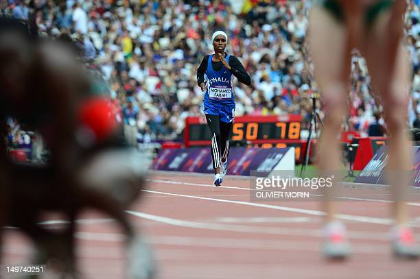 Somalia's Zamzam Mohamed Farah competes in the women's 400m heats at the athletics event during the London 2012 Olympic Games on August 3 2012 in...