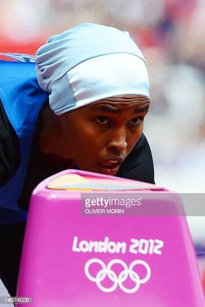 Somalia's Zamzam Mohamed Farah takes the start of the women's 400m heats at the athletics event during the London 2012 Olympic Games on August 3 2012...