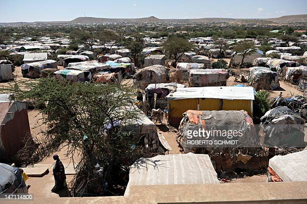 SomaliaunrestdisplacedUN Rapists hunger and hyenas stalk displaced Somali women by Helen Vesperini A Somali woman walks amid temporary structures in...
