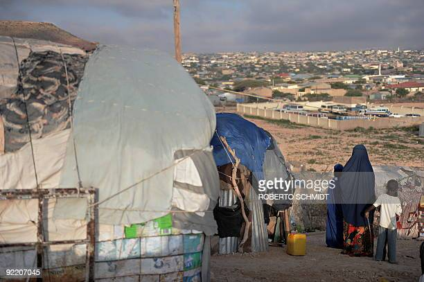 SomaliaunrestdisplacedUN Rapists hunger and hyenas stalk displaced Somali women by Helen Vesperini Halima and her two children stand in front of...