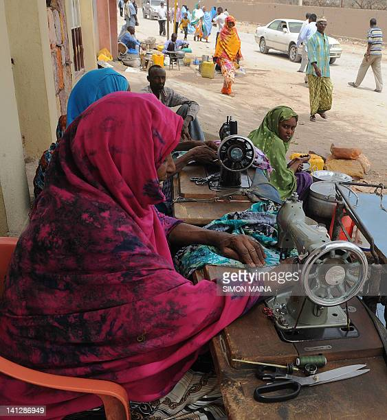 Somaliland women sew on March 8 2012 on a dusty street of Hargeisa in Somaliland the northern breakaway nation of wartorn Somalia While war rages in...