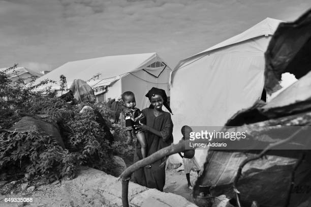 Somalis are seen living side by side in overcrowded camps for internally displaced people fleeing severe drought in the rest of the country Mogadishu...