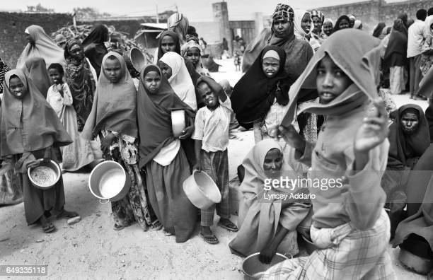 Somalis await a food distribution by the World Food Program in Mogadishu Somalia on Aug 27 2011