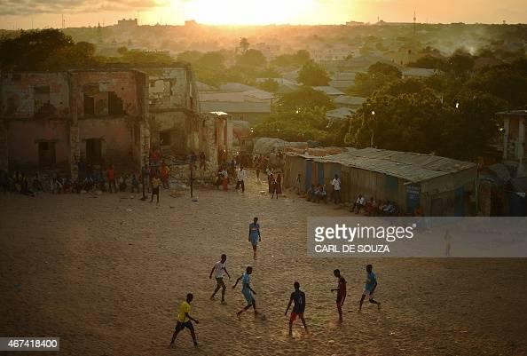 Somalis play football as the sun sets in Mogadishu on March 24 2015 AFP PHOTO/Carl de Souza