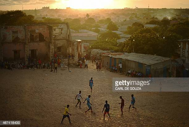 Somalis play football as the sun sets in Mogadishu on March 24 2015 AFP PHOTO/Carl de Souza