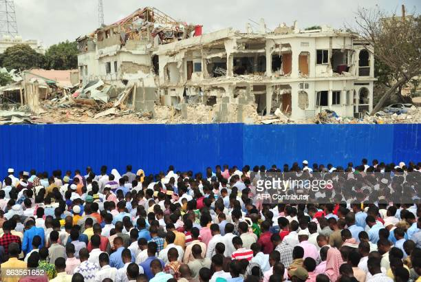 TOPSHOT Somalis pray for victims during Friday prayer on October 20 2017 in Mogadishu on the scene of a massive truck bomb attack in which at least...