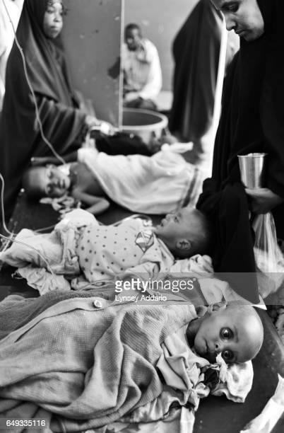 Somalis tend to their malnourished children at Banadir Hospital in Mogadishu Somalia on Aug 27 2011