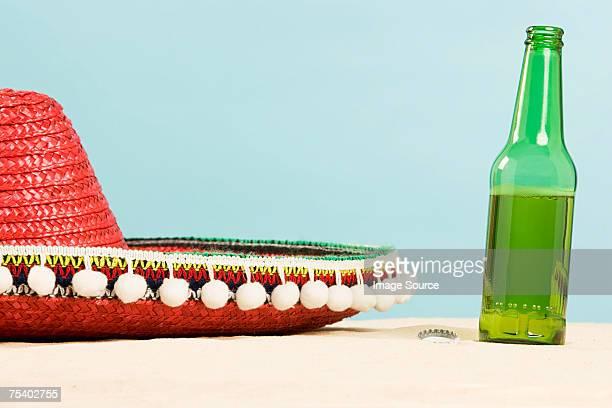 Sombrero and beer bottle