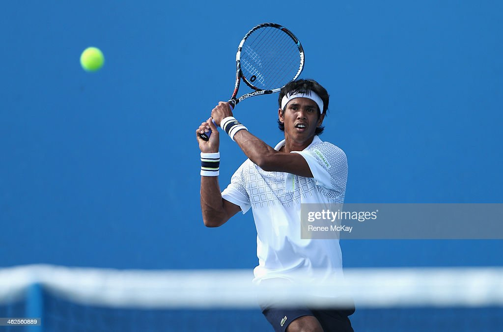<a gi-track='captionPersonalityLinkClicked' href=/galleries/search?phrase=Somdev+Devvarman&family=editorial&specificpeople=5487712 ng-click='$event.stopPropagation()'>Somdev Devvarman</a> of India plays a backhand in his first round match against Feliciano Lopez of Spain during day two of the 2014 Australian Open at Melbourne Park on January 14, 2014 in Melbourne, Australia.