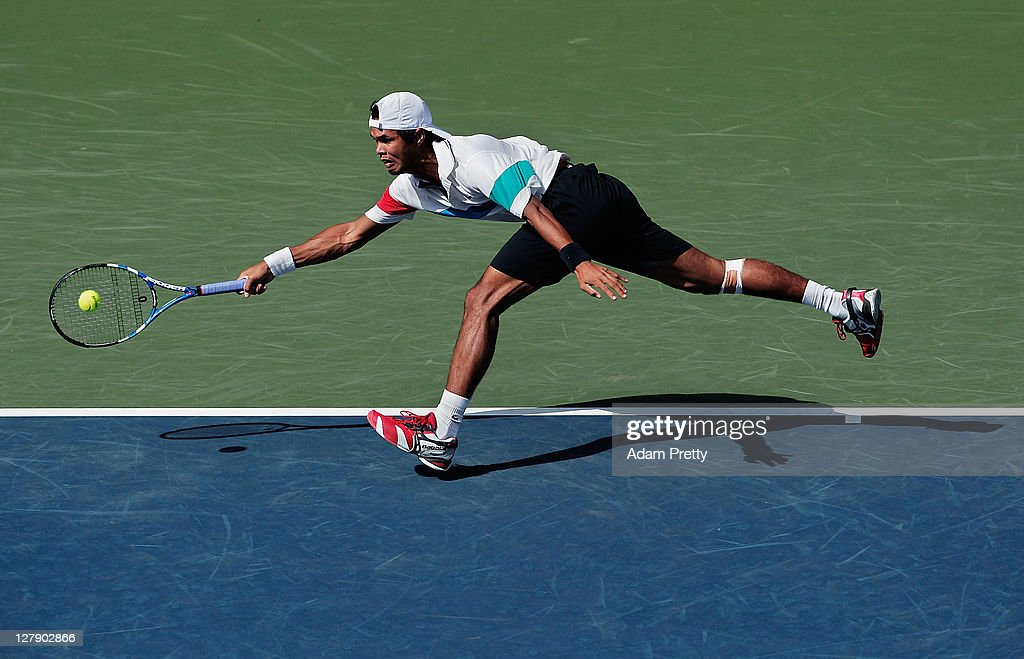 <a gi-track='captionPersonalityLinkClicked' href=/galleries/search?phrase=Somdev+Devvarman&family=editorial&specificpeople=5487712 ng-click='$event.stopPropagation()'>Somdev Devvarman</a> of India plays a forehand during his first round match against Radek Stepanek of the Czech Republic during day one of the Rakuten Open at Ariake Colosseum on October 3, 2011 in Tokyo, Japan.