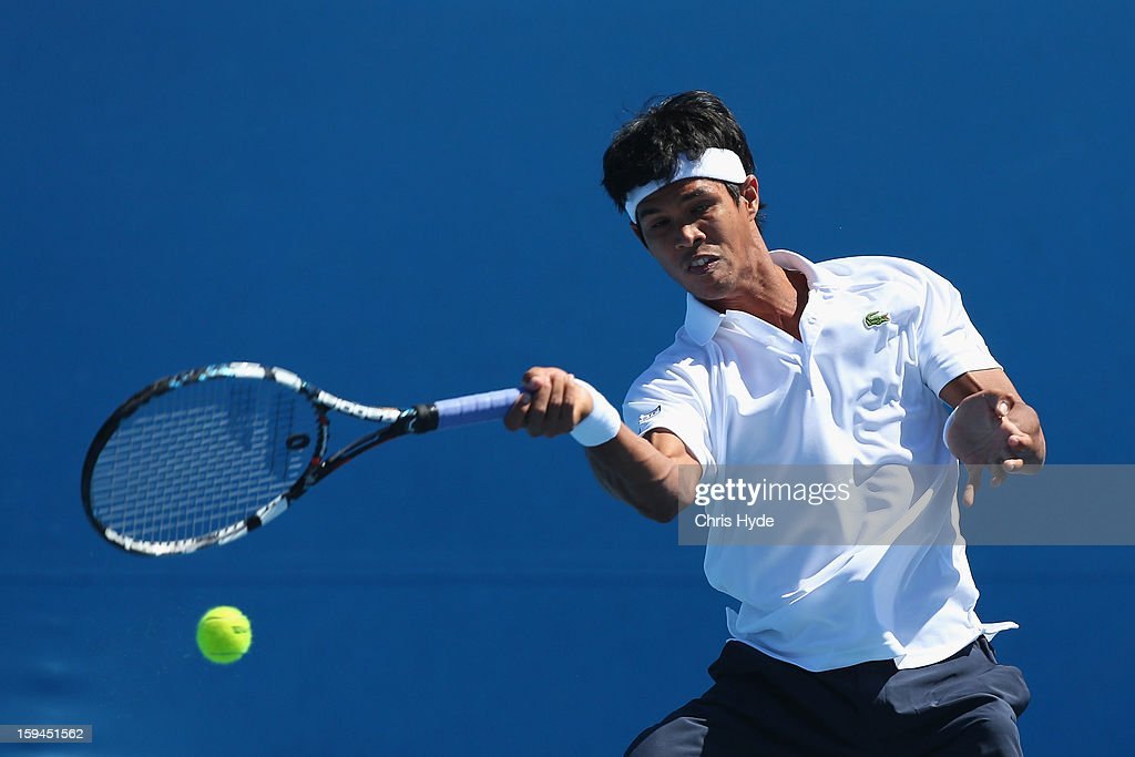 <a gi-track='captionPersonalityLinkClicked' href=/galleries/search?phrase=Somdev+Devvarman&family=editorial&specificpeople=5487712 ng-click='$event.stopPropagation()'>Somdev Devvarman</a> of India plays a forehand in his first round match against Bjorn Phau of Germany during day one of the 2013 Australian Open at Melbourne Park on January 14, 2013 in Melbourne, Australia.
