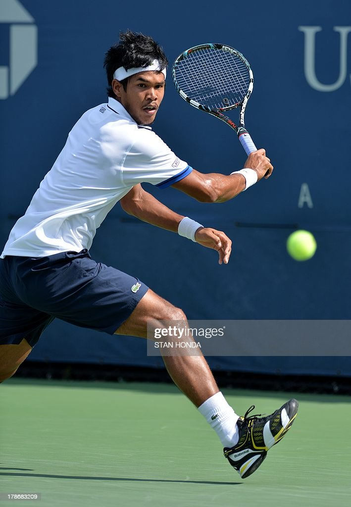 Somdev Devvarman of India returns a shot to Andreas Seppi of Italy during their 2013 US Open men's singles match at the USTA Billie Jean King National Tennis Center August 30, 2013 in New York. AFP PHOTO/Stan HONDA