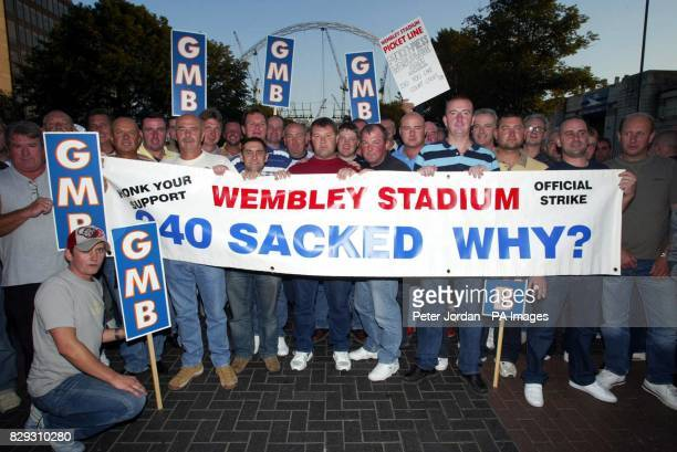 Some 100 workers sacked during the building of the new Wembley Stadium protest before a glittering ceremony to mark the 'topping out' ceremony when...