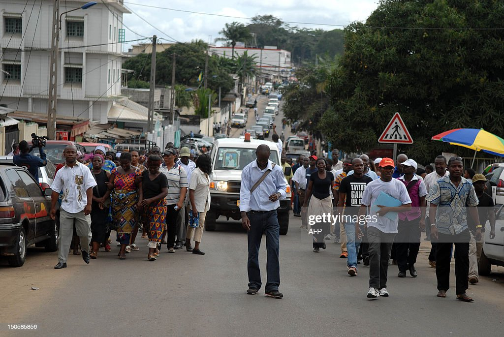 Some 150 people take part on August 22 2012 to the funeral of a woman who died during clashes in Gabon's capital Libreville on August 15 Tensions in...