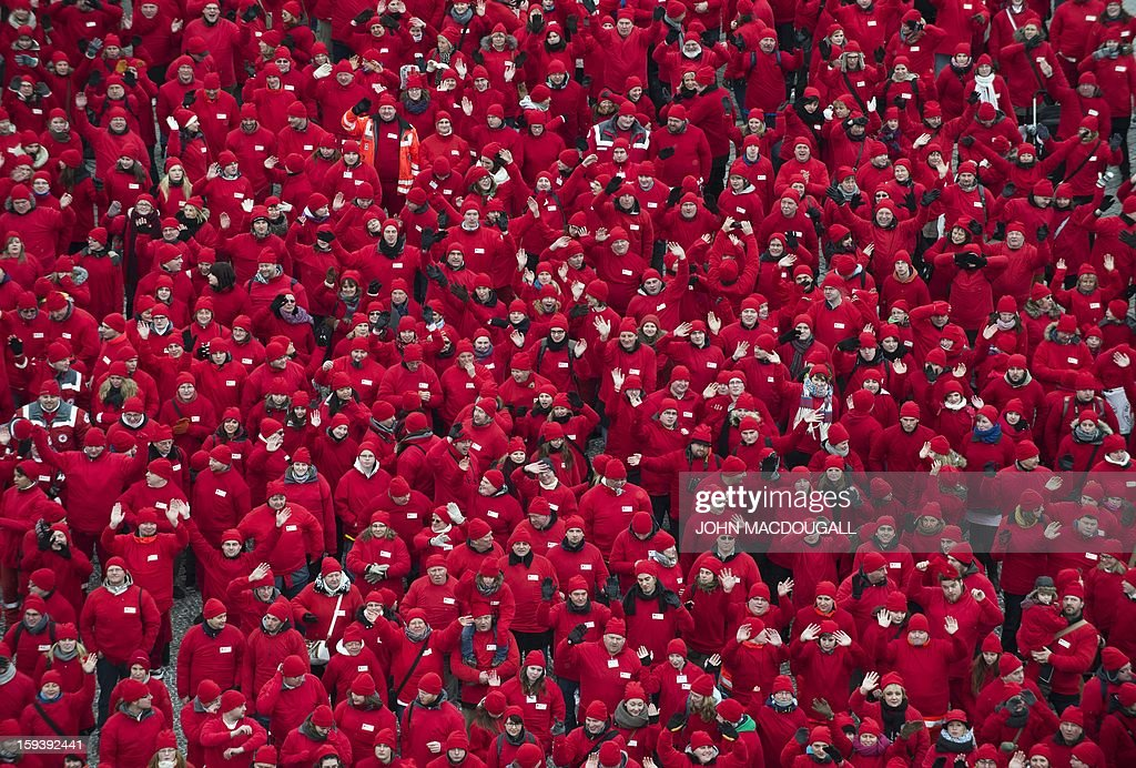 Some 1800 volunteers of the German Red Cross (Deutsches Rotes Kreuz-DRK) gather to form a giant red cross next to Berlin's Brandenburg Gate, on January 13, 2013, on the occasion of the organisation's 150th anniversary.
