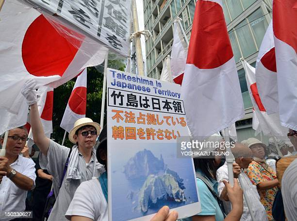 Some 200 Japanese nationalists raise national flags to protest against a visit by South Korean President Lee MyungBak on August 10 to disputed...
