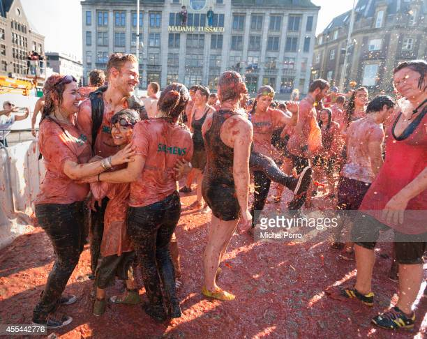 Some 2000 people take part in a tomato fight organised on Dam Square in front of the Royal Palace in support of Dutch vegetable growers hurt by the...